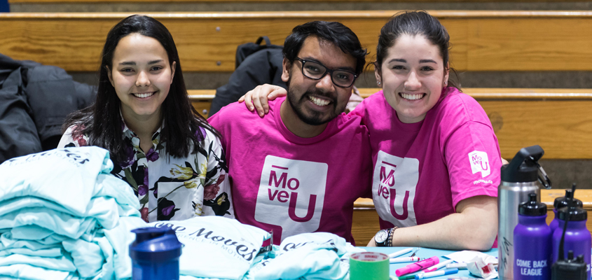 Three MoveU crew members at an event