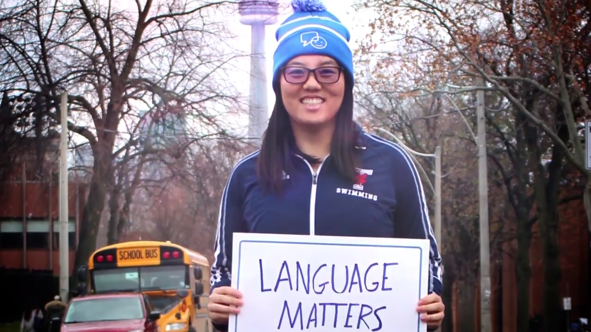 Varsity Blues Nathalin Moy holds up a sign for Bell Canada's Let Talk mental health campaign