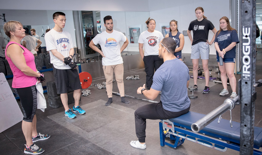 male fitness coach leads skills workshop
