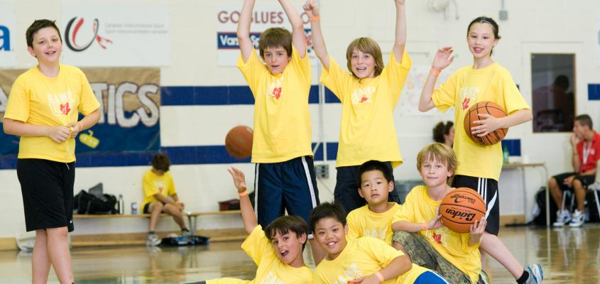 A group of boys pose with basketballs