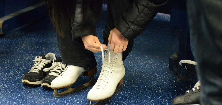 Girl lacing up figure skates