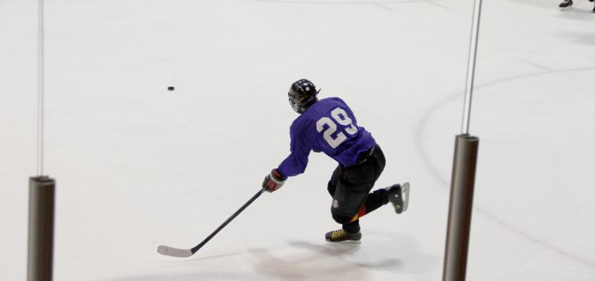 Hockey player taking a slap shot