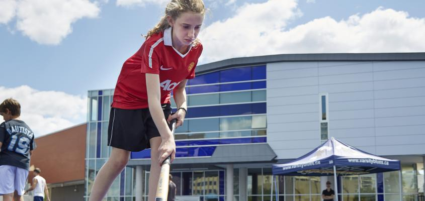 A young Girl learns the fundamentals of field hockey
