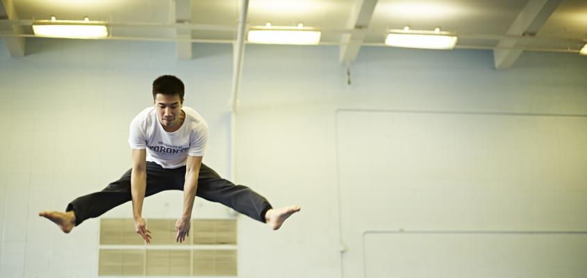 Man leaping over a structure
