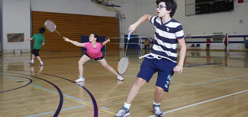 Two youngsters play mixed doubles
