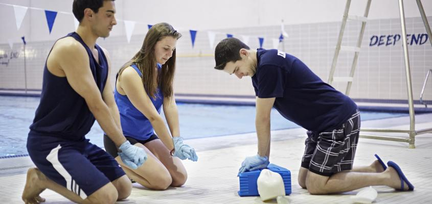 ad9d46b57169 Swimming Certifications. An instructor demonstrates CPR