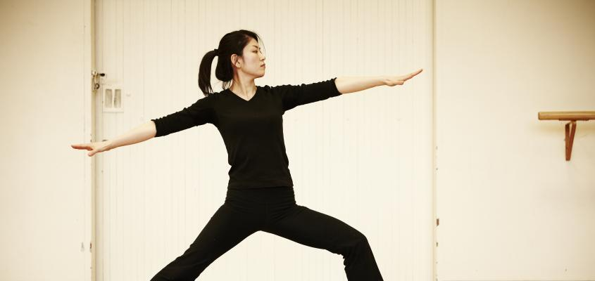 A woman in Warrior pose