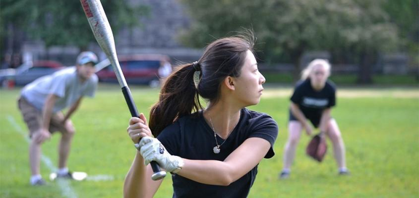 student playing softball