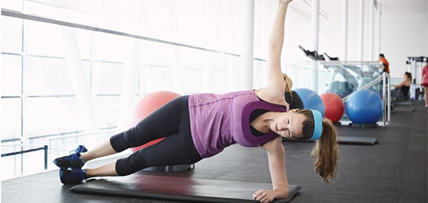 woman holding plank pose