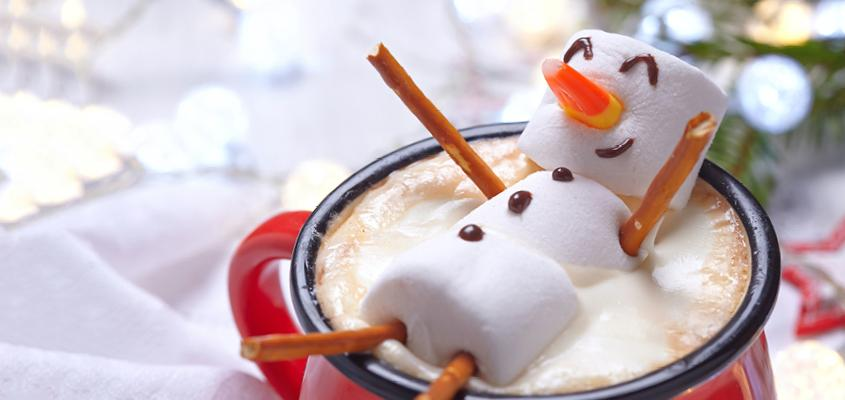 Snow man made of marshmallows in a  cup of hot chocolate
