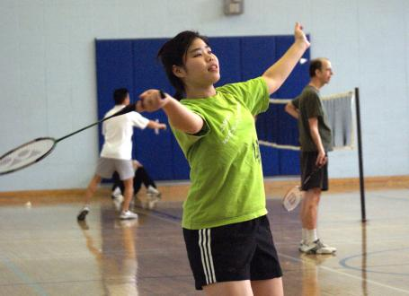 girl playing badminton