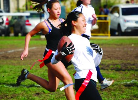 Women playing flag football